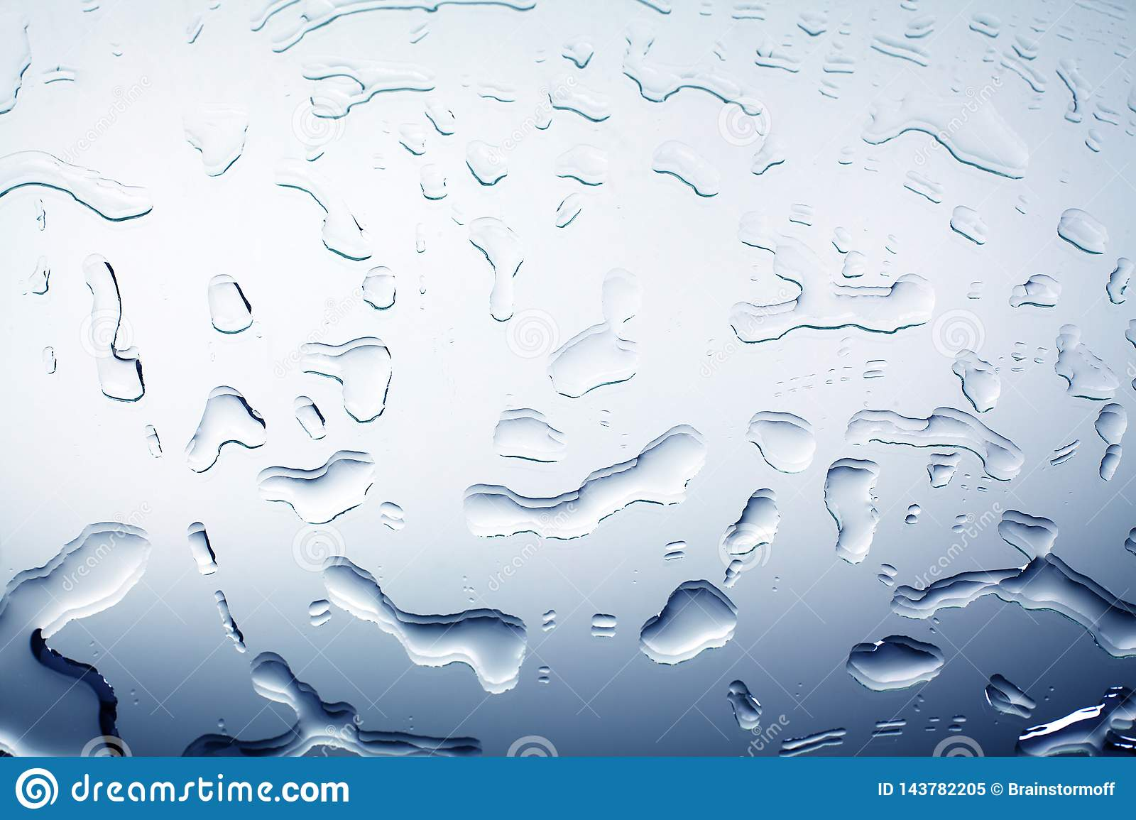 Drops of spilled water on mirror glass surface, water blots, abstract design background, wet textured gradient pattern blue color