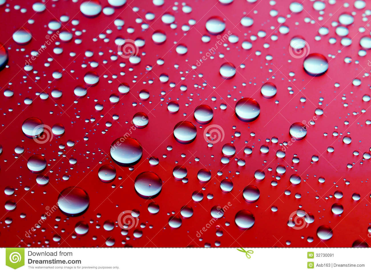 drops of water on a red background stock image