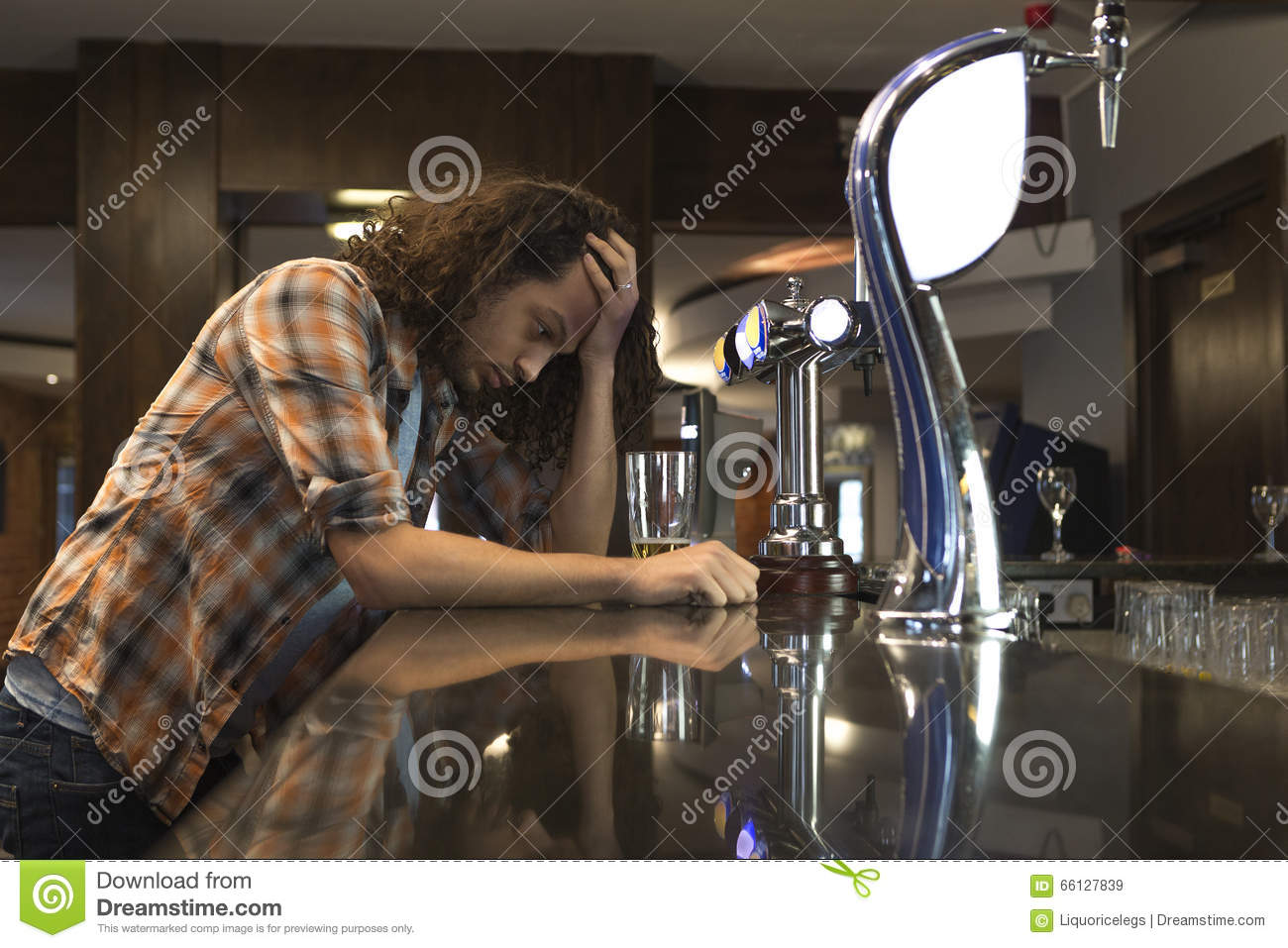 Image result for man drowning his sorrows in beer