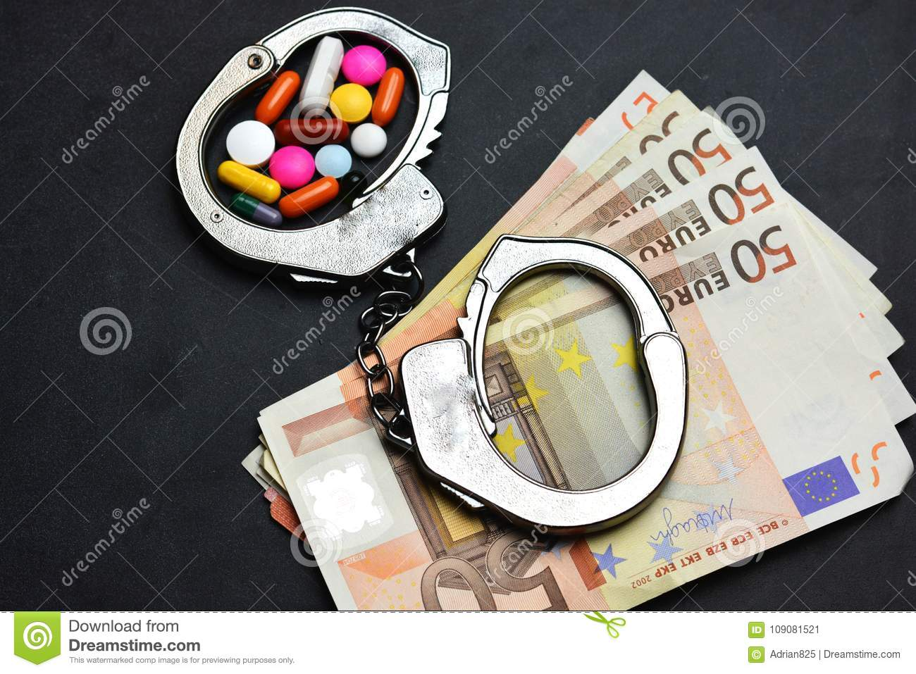 Drugs trafficking is illegal, with pills or narcotics in handcuffs on euro banknotes