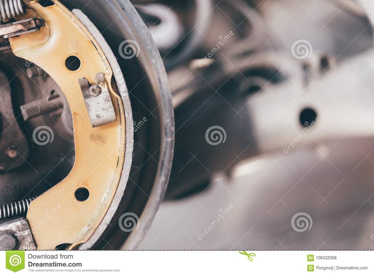 Drum brake and asbestos brake pads it s a part of car use for stop the car  for safety at rear wheel this a new spare part for repair at car garage 6603c18e1