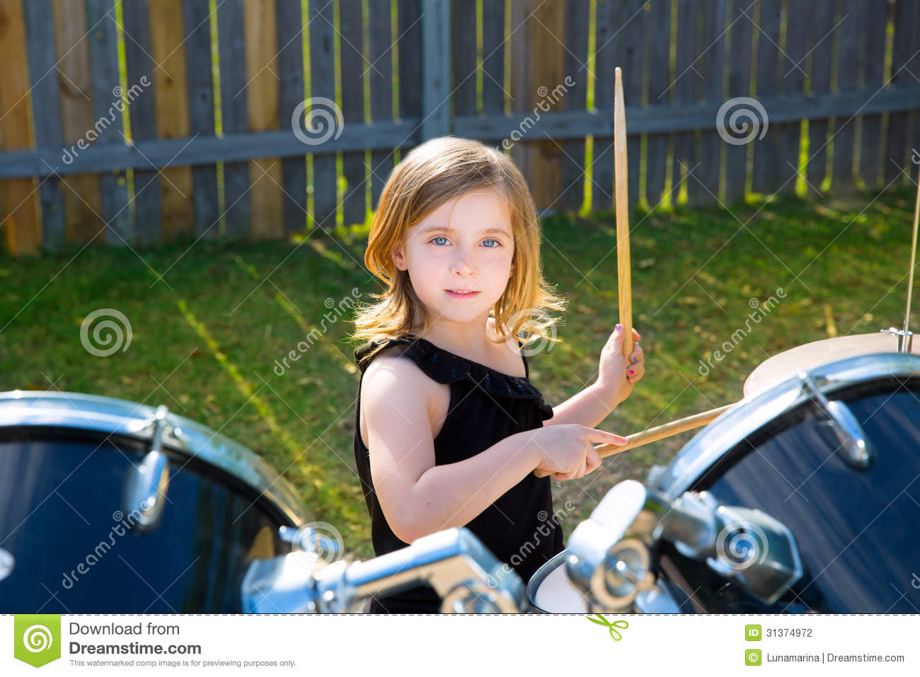 Drummer Blond Kid Girl Playing Drums In Tha Backyard Stock -5163