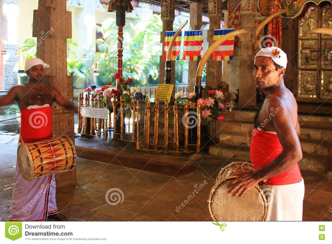 Drummers dressed with traditional clothes at Temple of the Sacred Tooth Relic (Sri Lanka)