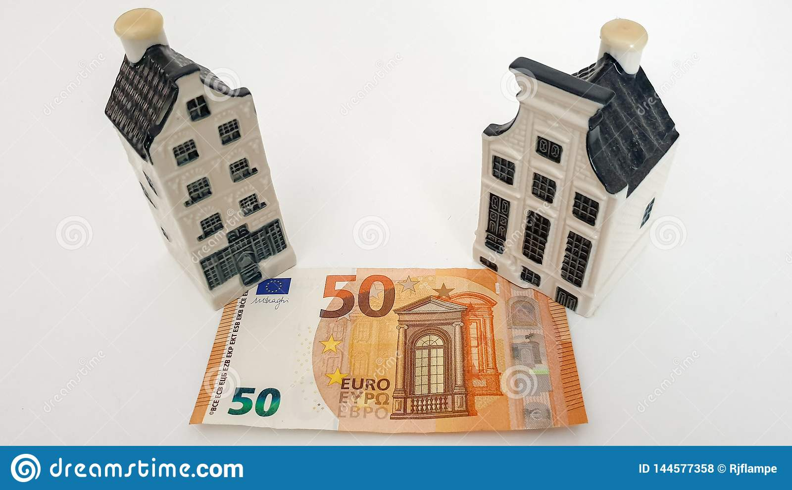Drunen, Nederland - April 9 2019: KLM Delft Blue House with Money, Currency Euro. 50 euro. Miniature house with mortgage