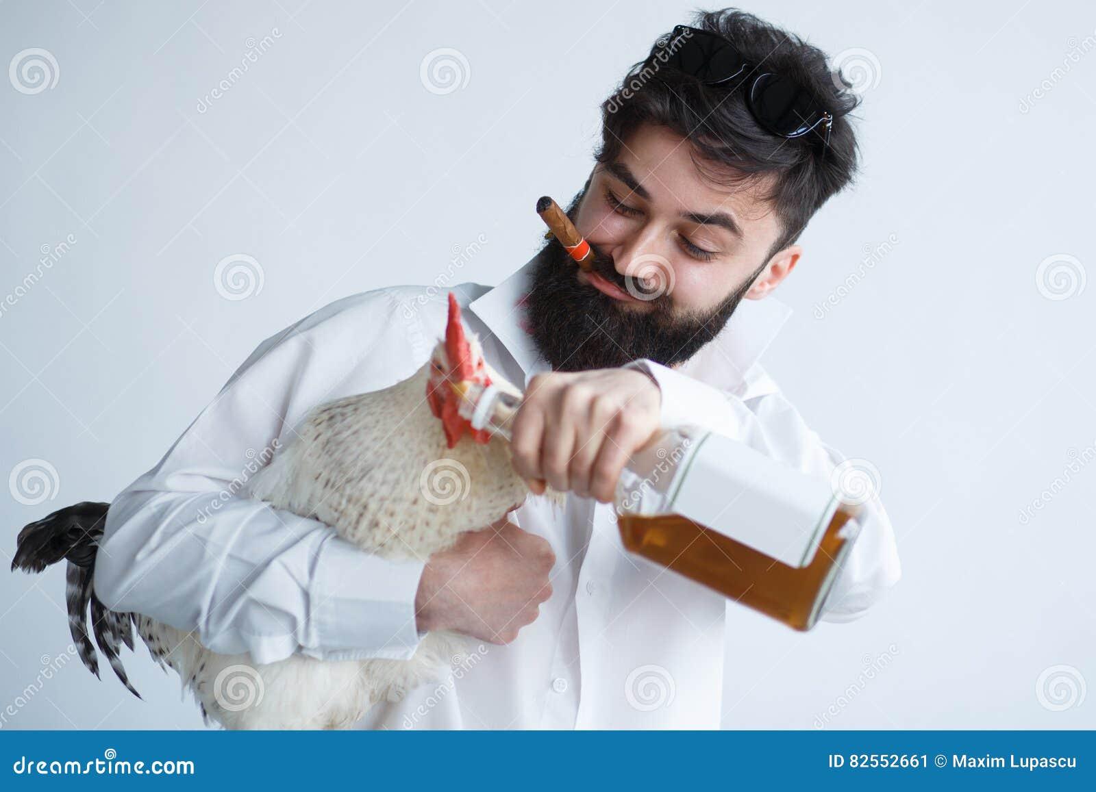 Drunk crazy man with chicken