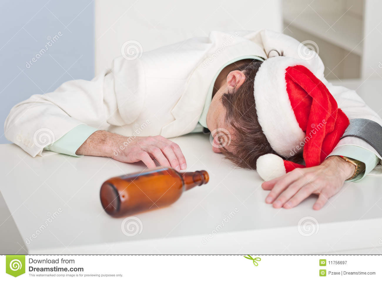 Drunk Person Lies On Table Royalty Free Stock Photography