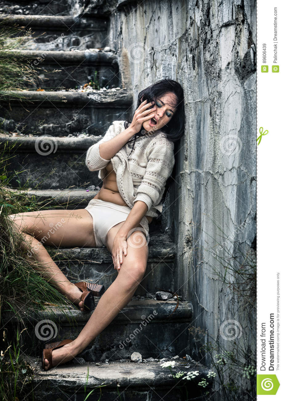 Drunk young woman on the stairs