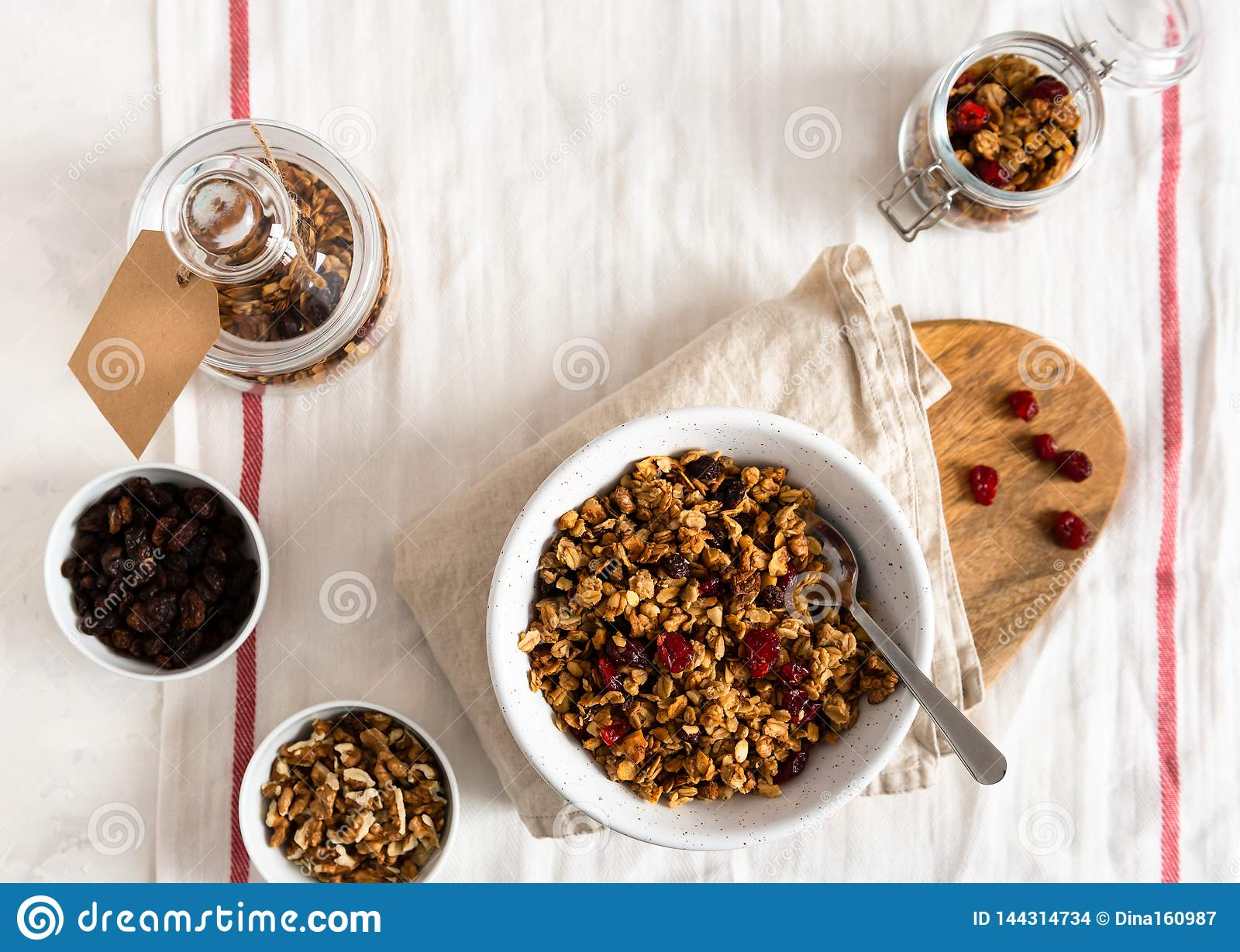 Dry breakfast cereals. Crunchy honey granola bowl with flax seeds, cranberries and coconut. Healthy, vegeterian fiber food.