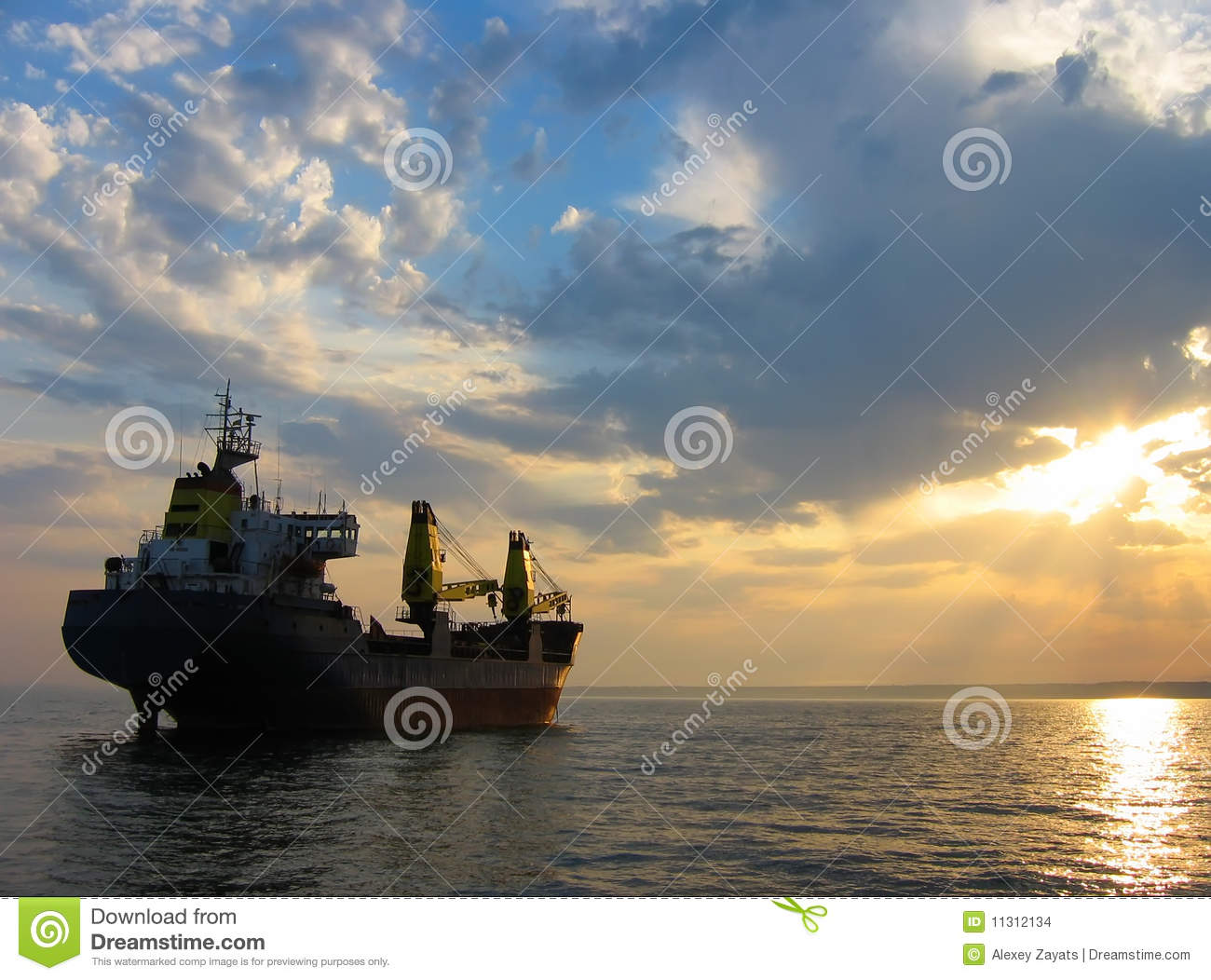Dry Cargo Ship At Sunset