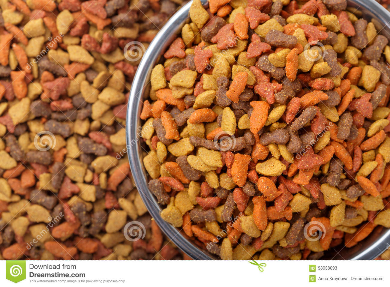 dry cat dog food in granules. Pet treats in metal bowl