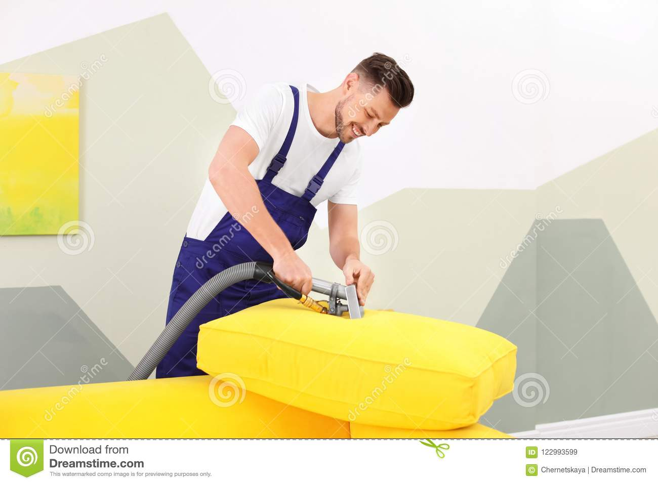 Dry Cleaning Worker Removing Dirt From Sofa Cushion Stock Image