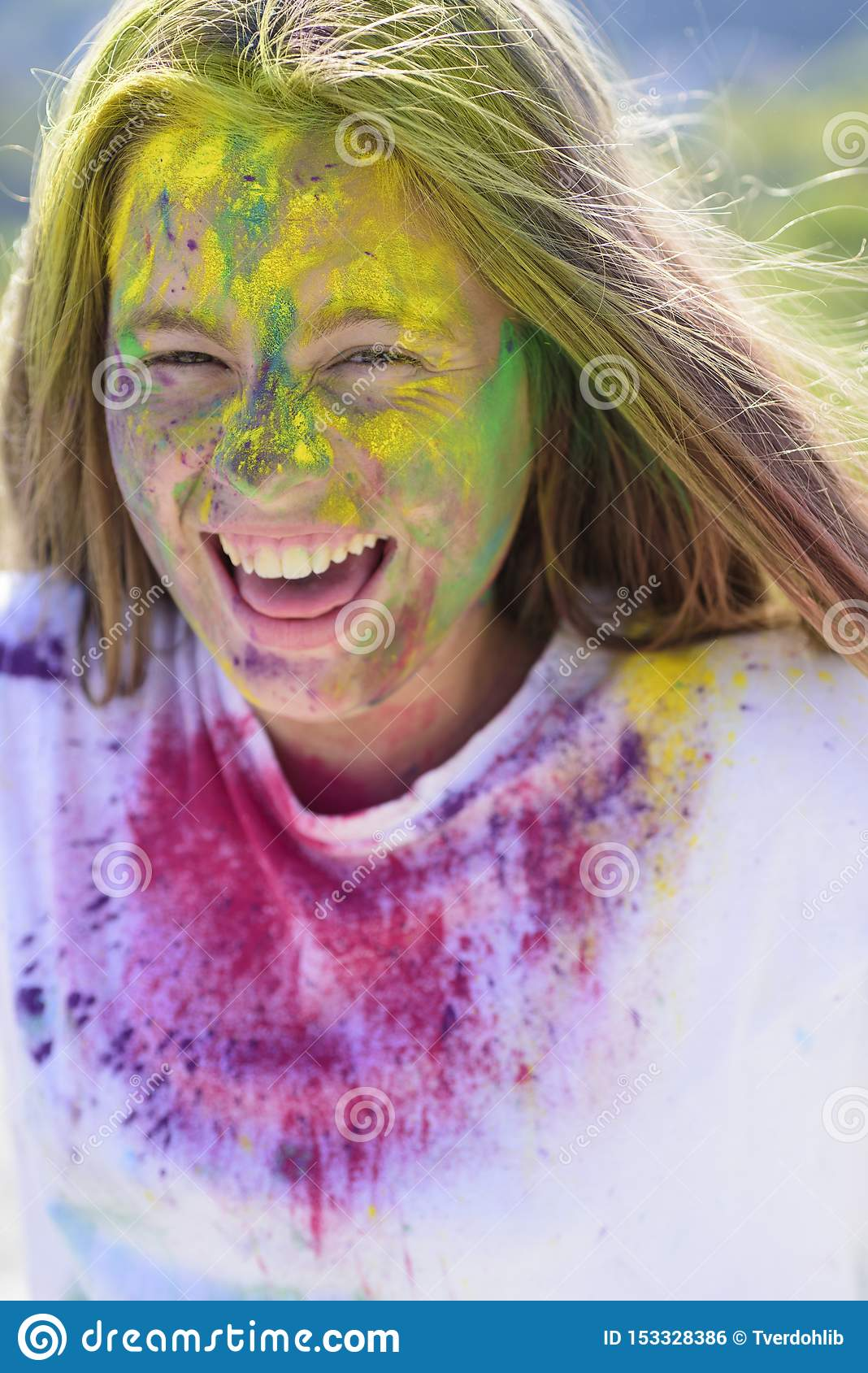Dry color on face. holi. colorful neon paint makeup. Crazy hipster girl. Summer weather. Happy youth party. Optimist