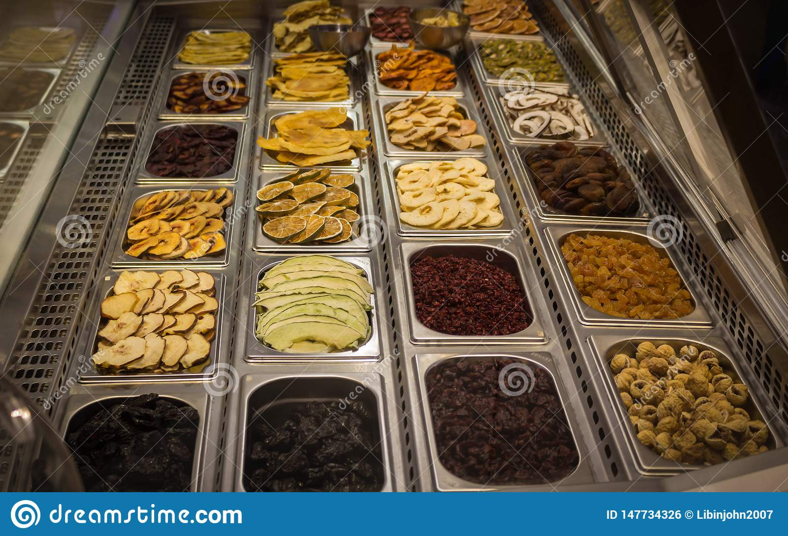 Dry Fruits kept on steel tray for selling in Dubai mall