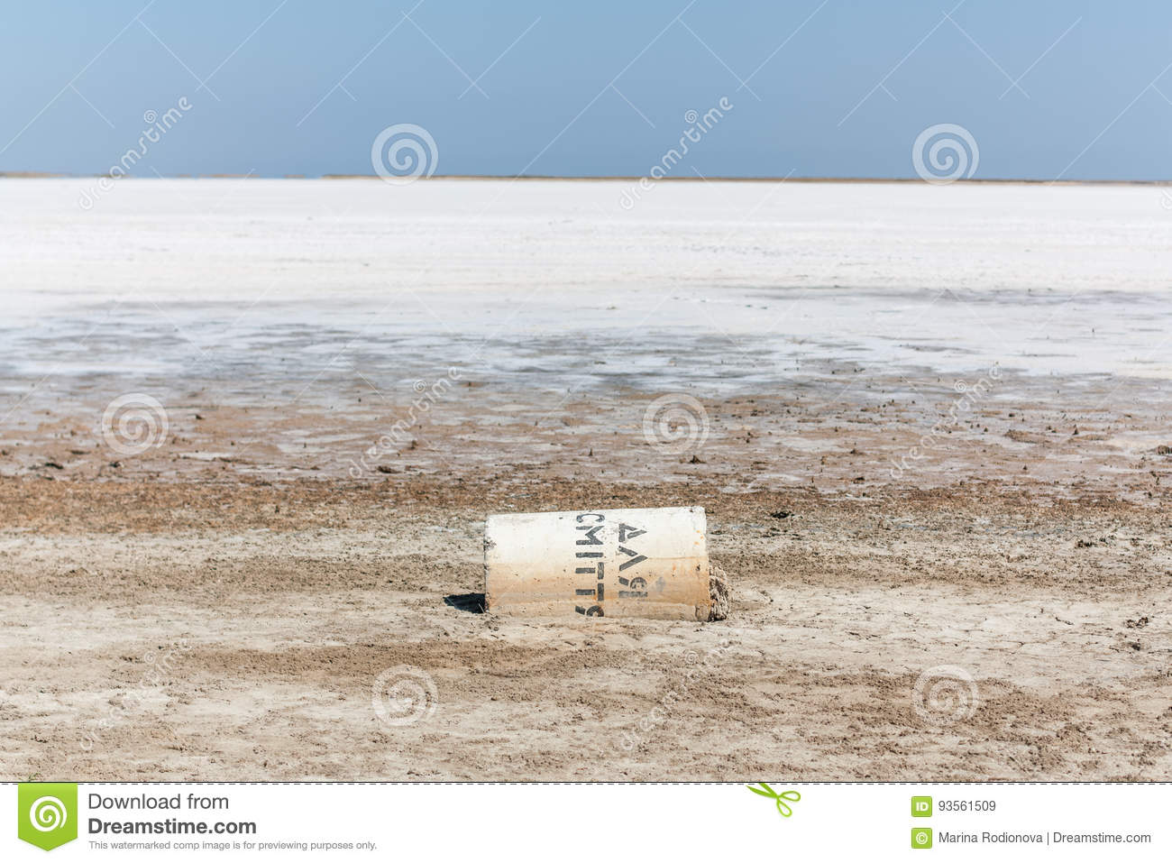Dry salt lake with a fallen container