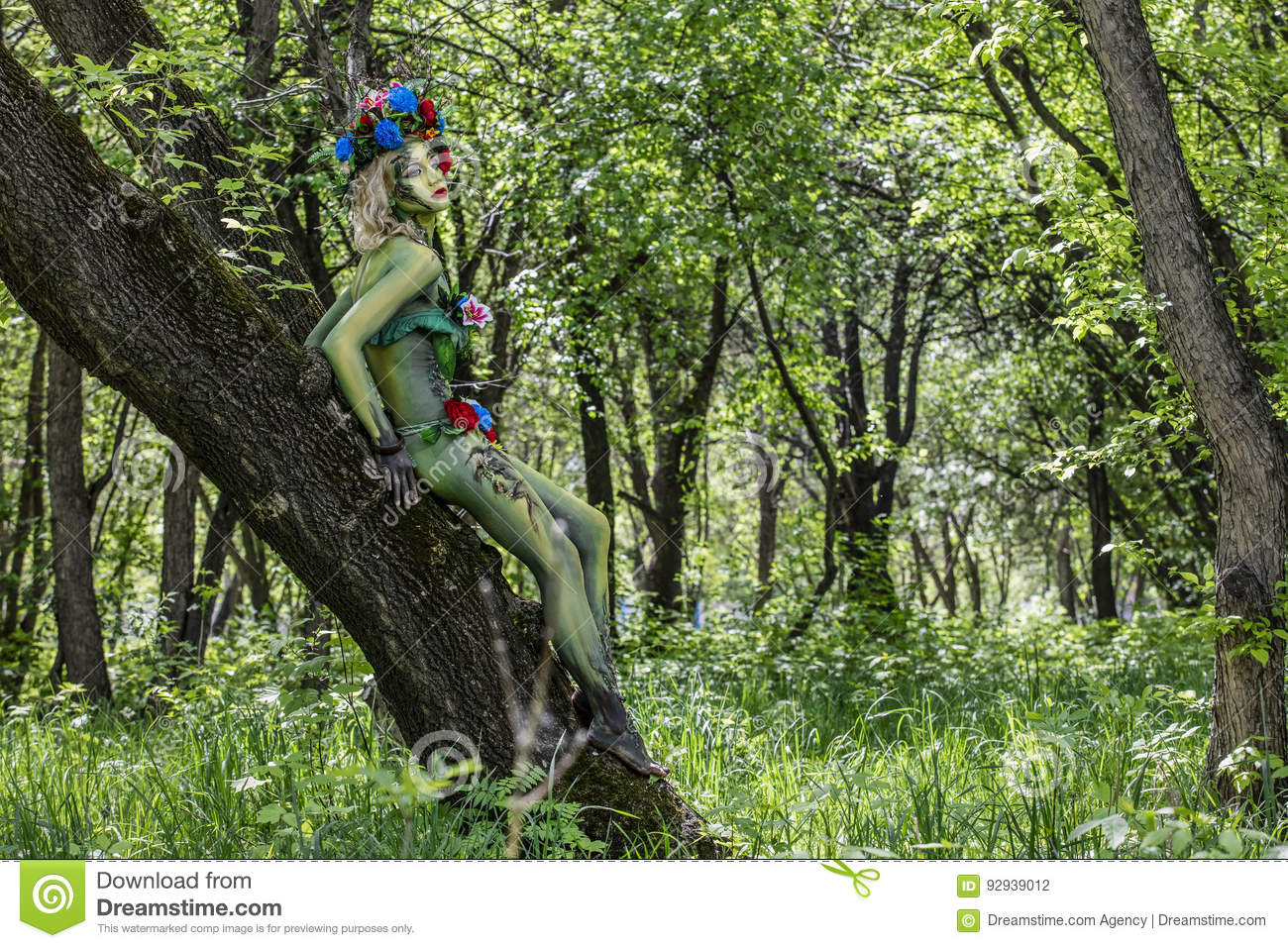Dryad on the tree in a wild garden one with the green nature