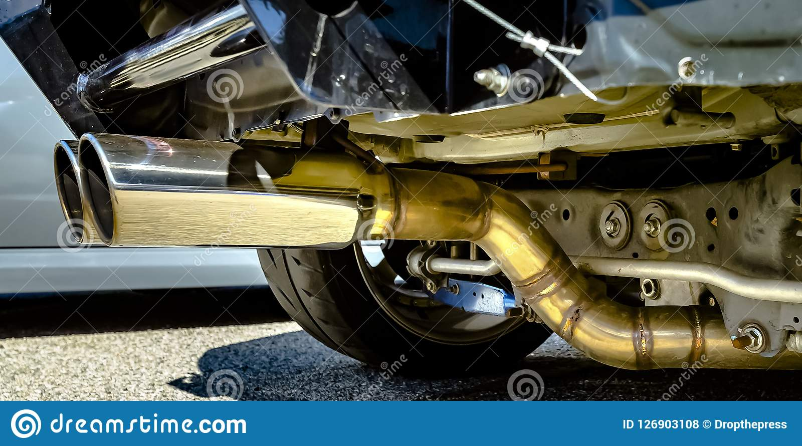 Dual Chrome Exhaust Pipe At The Bottom Of A Car Stock Photo