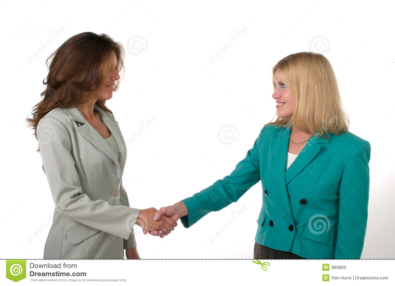 Duas mulheres de negócio que agitam as mãos 1