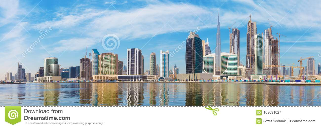 Dubai - The panorama with the new Canal and skyscrapers of Downtown