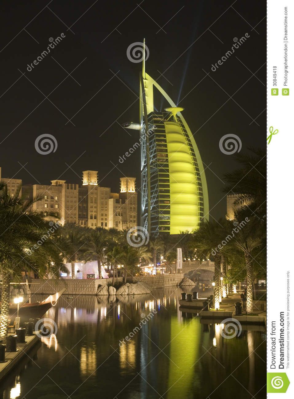 Dubai uae colourfully lit world famous burj al arab hotel for Dubai world famous hotel