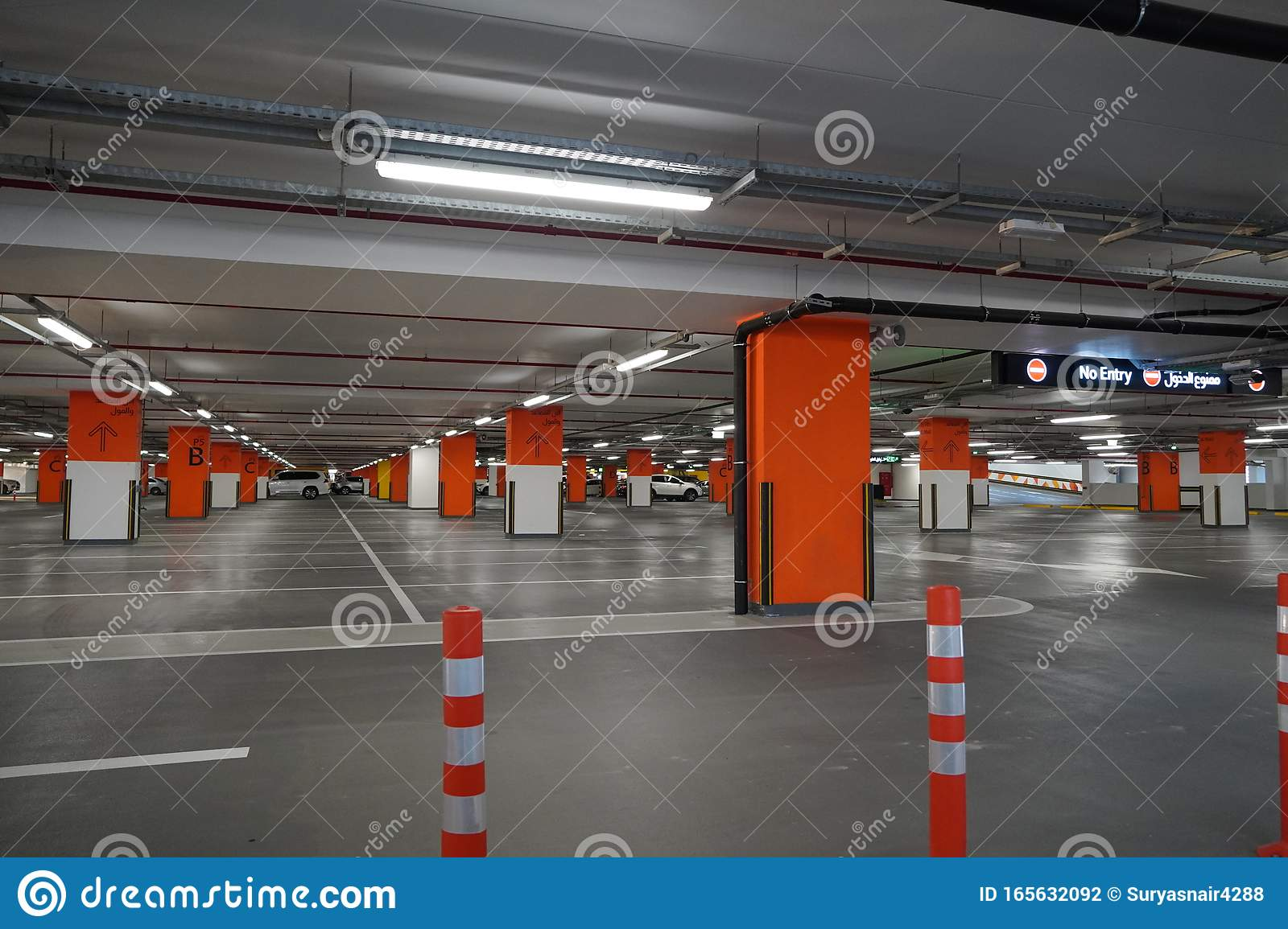 Dubai Uae December 2019 Underground Parking Which Is Almost Empty Empty Garage In Basement Of Office Building Reinforced Editorial Photography Image Of Basement Floor 165632092