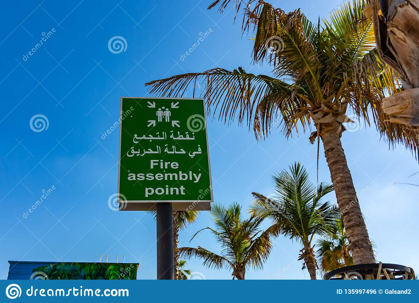 Dubai, United Arab Emirates - December 12, 2018: Fire Assembly Point Sign in Arabic and English