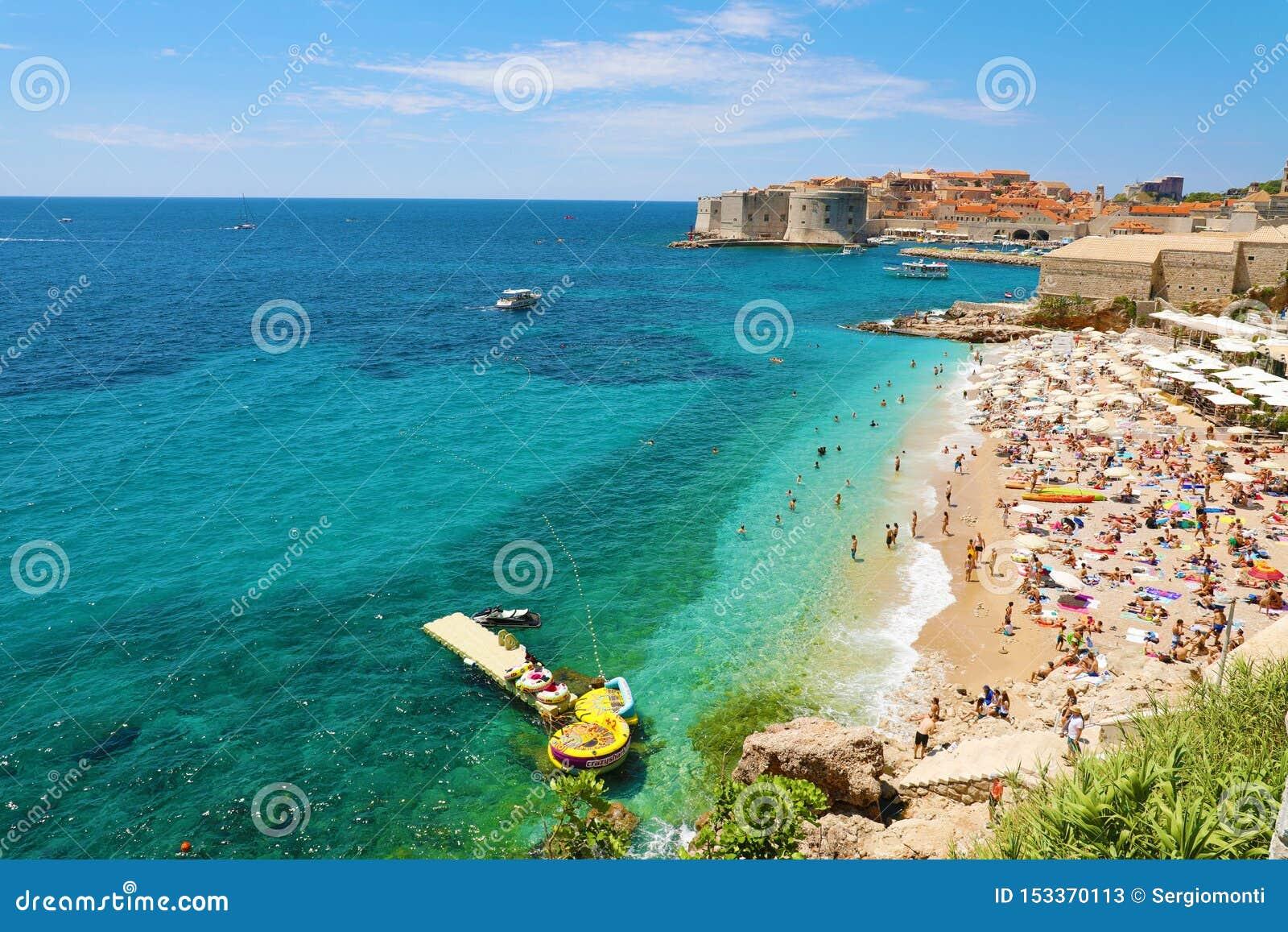 DUBROVNIK, CROATIA - JULY 12, 2019: Aerial view of Dubrovnik old town and Banje beach, Adriatic sea