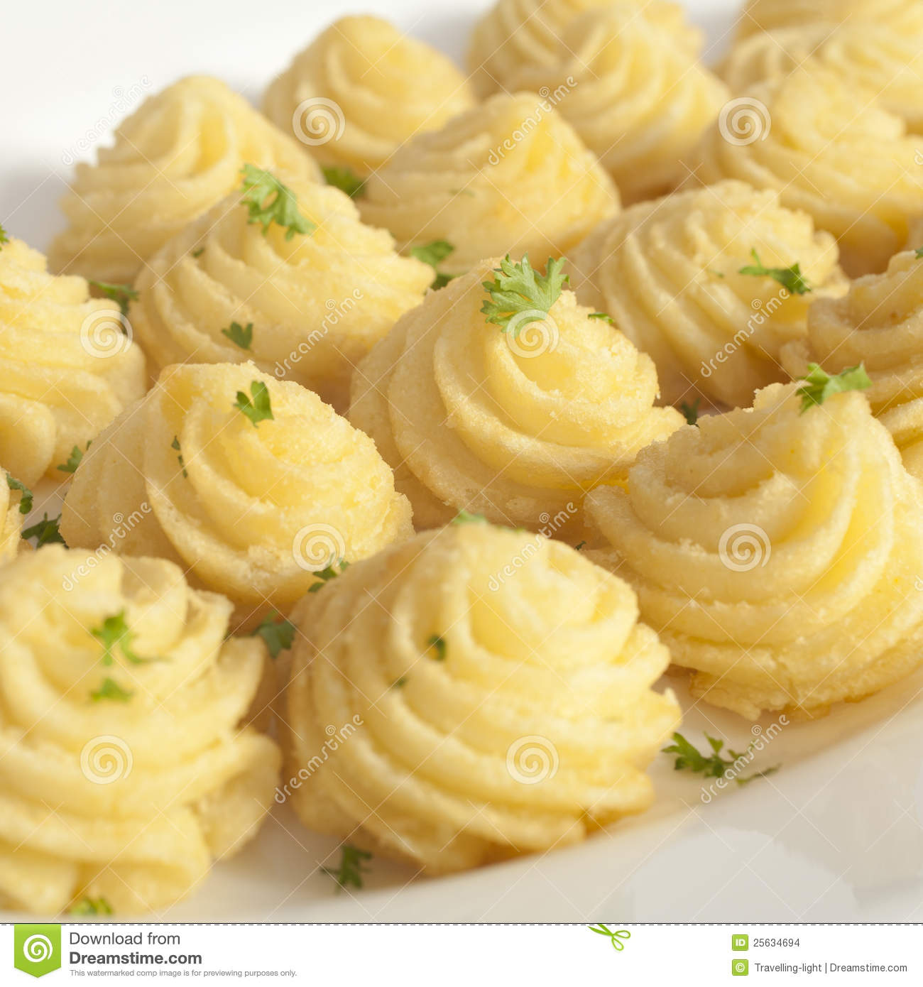 Duchess potatoes, mashed potato mixed with egg, piped into swirls and ...