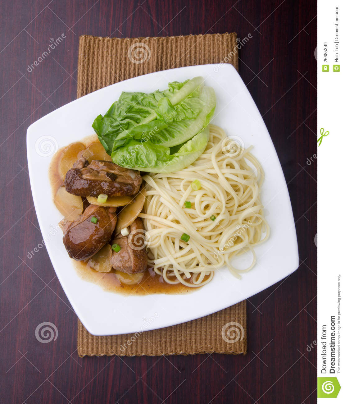 Duck noodle and vegetable in white plate