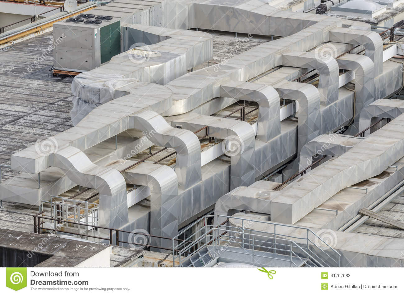 Air conditioning ductwork on a building roof top. #6C5F4D