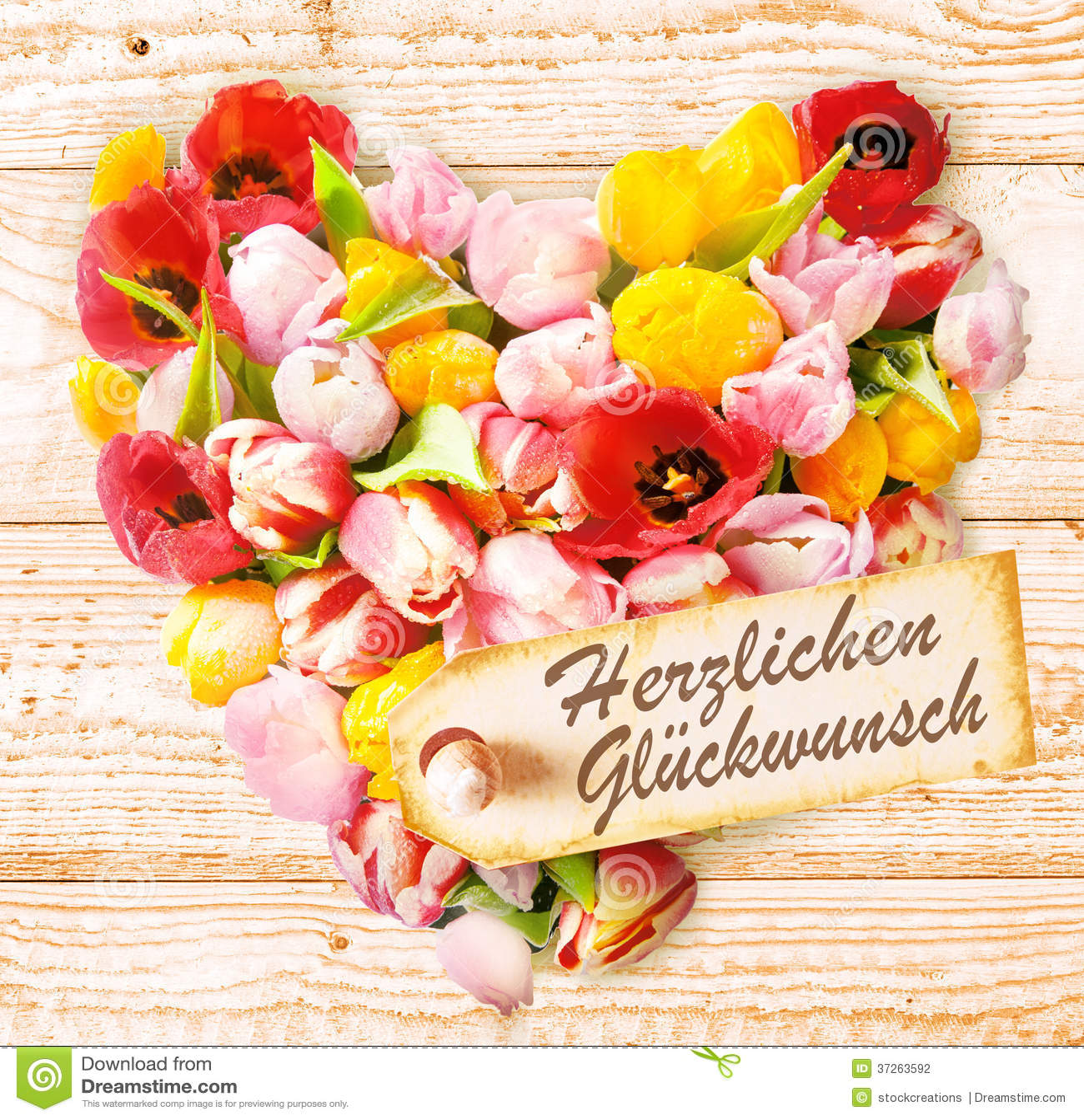 Duitse Verjaardagswensen Op Een Kleurrijk Bloemenhart Stock