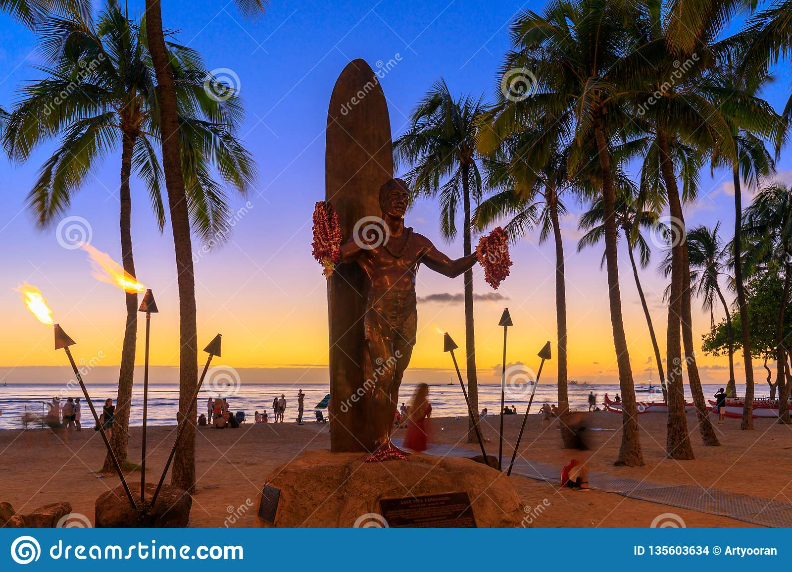 Duke Kahanamoku Iconic Statue At Sunset In Waikiki Beach