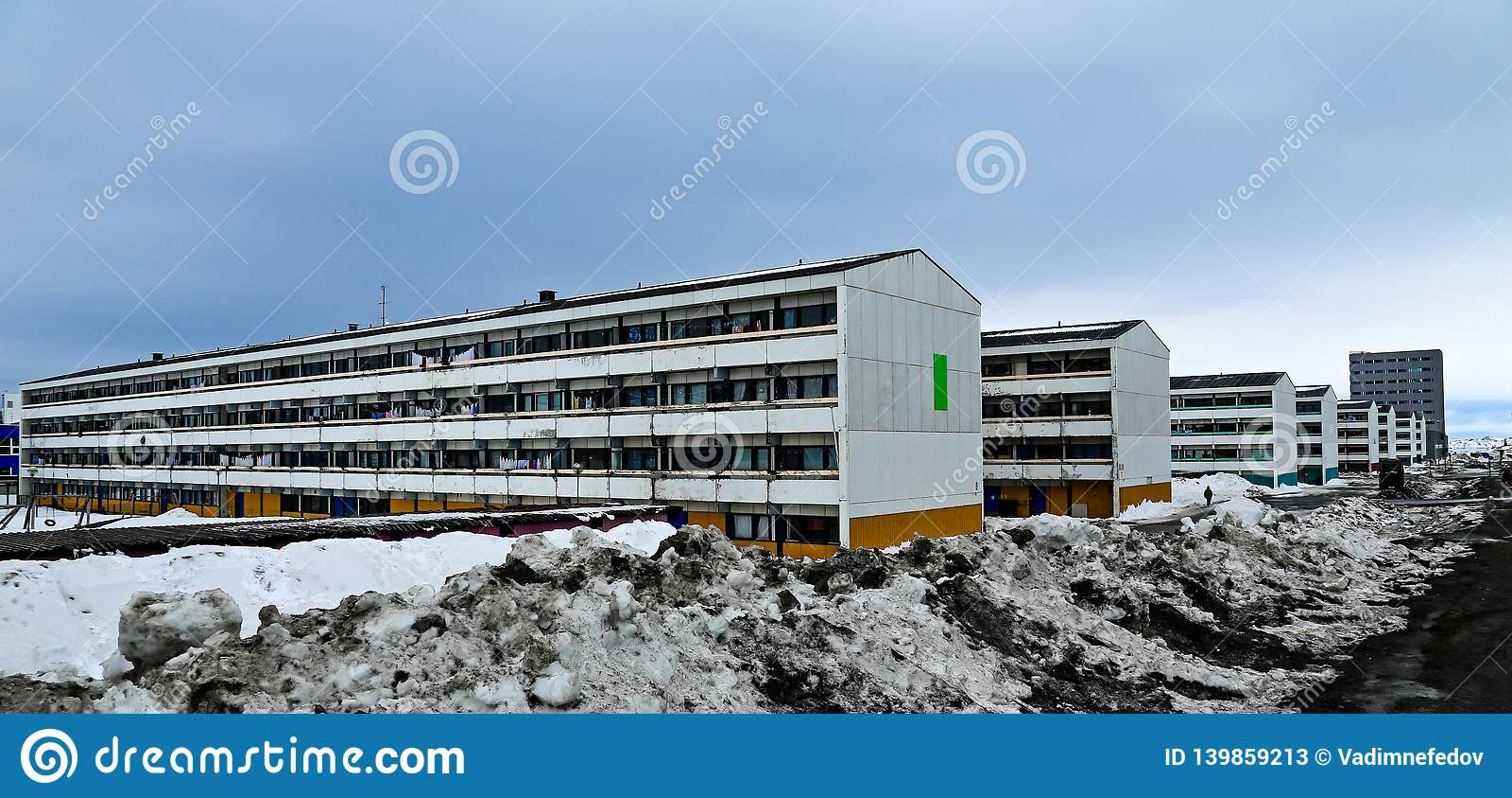 Dull rows of long Inuit living buildings in Arctic capital Nuuk