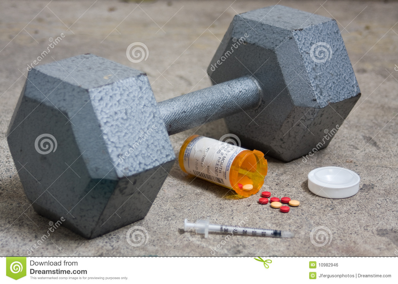 Dumbbell With Steroids And Needle Stock Photo