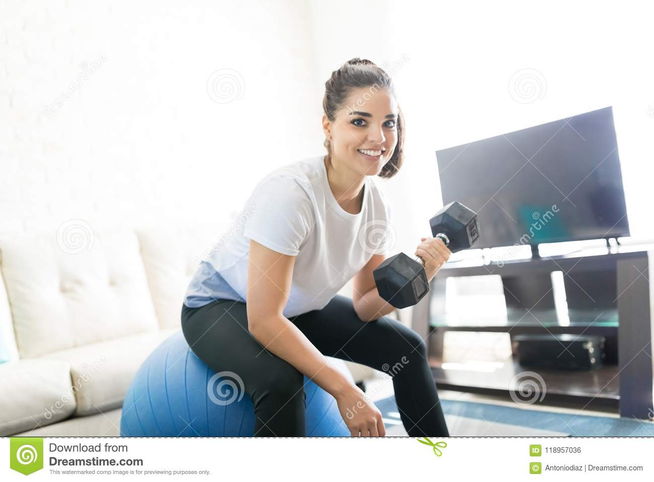 Dumbbell Workout On Swiss Ball Stock Photo - Image of lifting