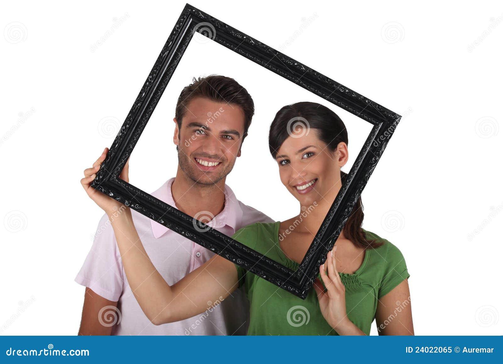 Dumme Paare Mit Bilderrahmen Stockbild - Bild von innen, dekoration ...