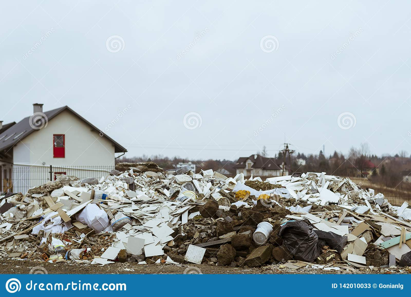 Dump in a residential area. Construction waste illegally thrown away in a residential area