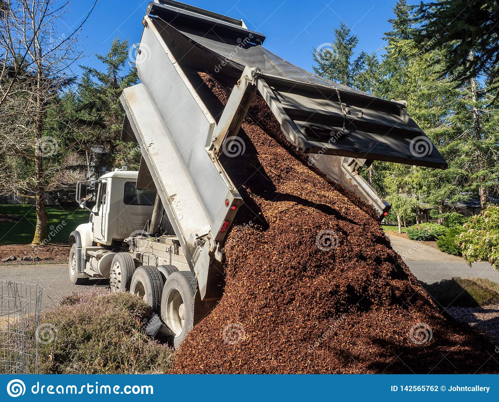 Dump Truck Dumping A Load Stock Photo Image Of Sand 142565762