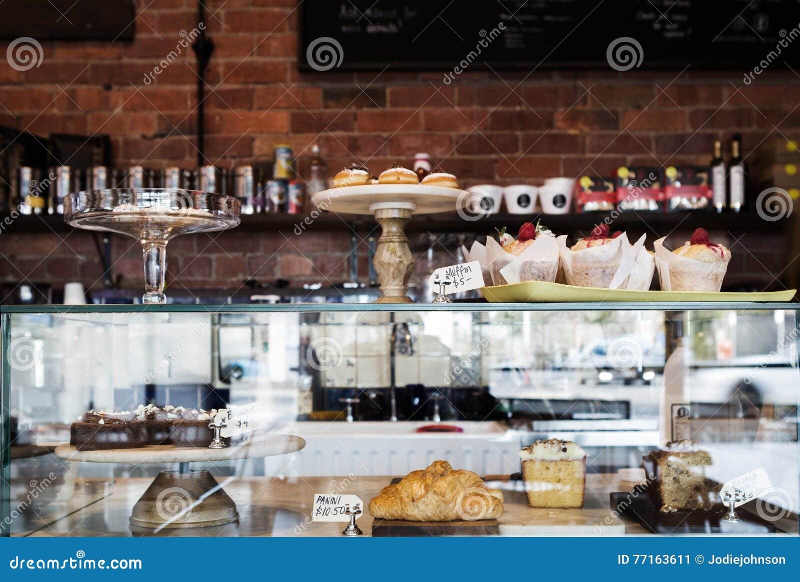 Durcissez la vitrine en café de Melbourne avec le mur rustique