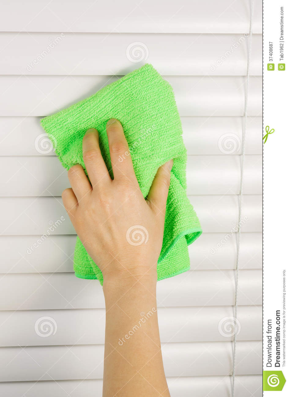 Dusting Window Blinds Royalty Free Stock Photography
