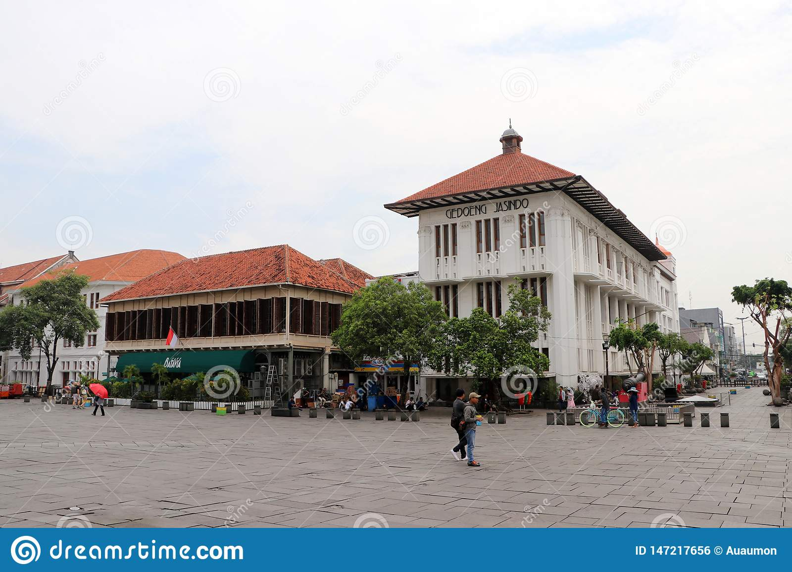 Dutch colonial building and locals walk through Fatahillah Square in Old Town, Jakarta