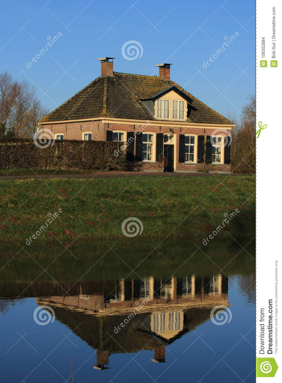 Dutch house mirrored in the water.