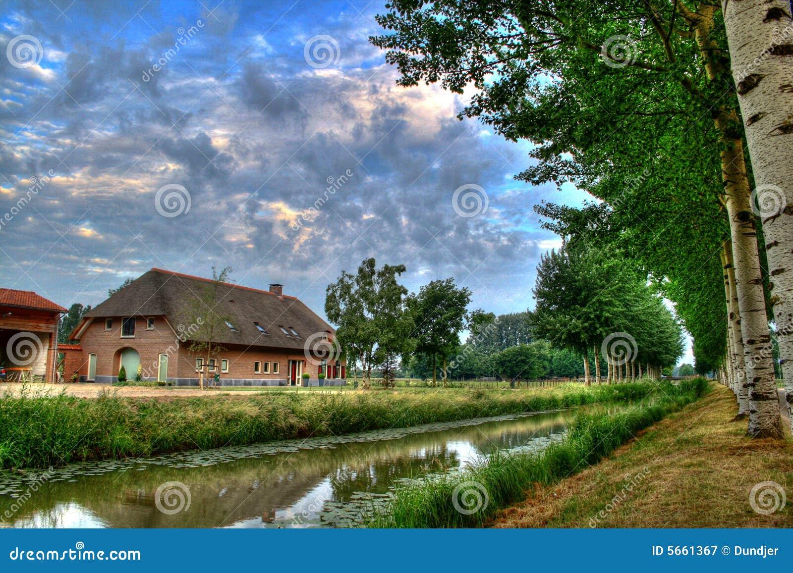 Dutch farm with dark blue ky royalty free stock for Farm house netherlands