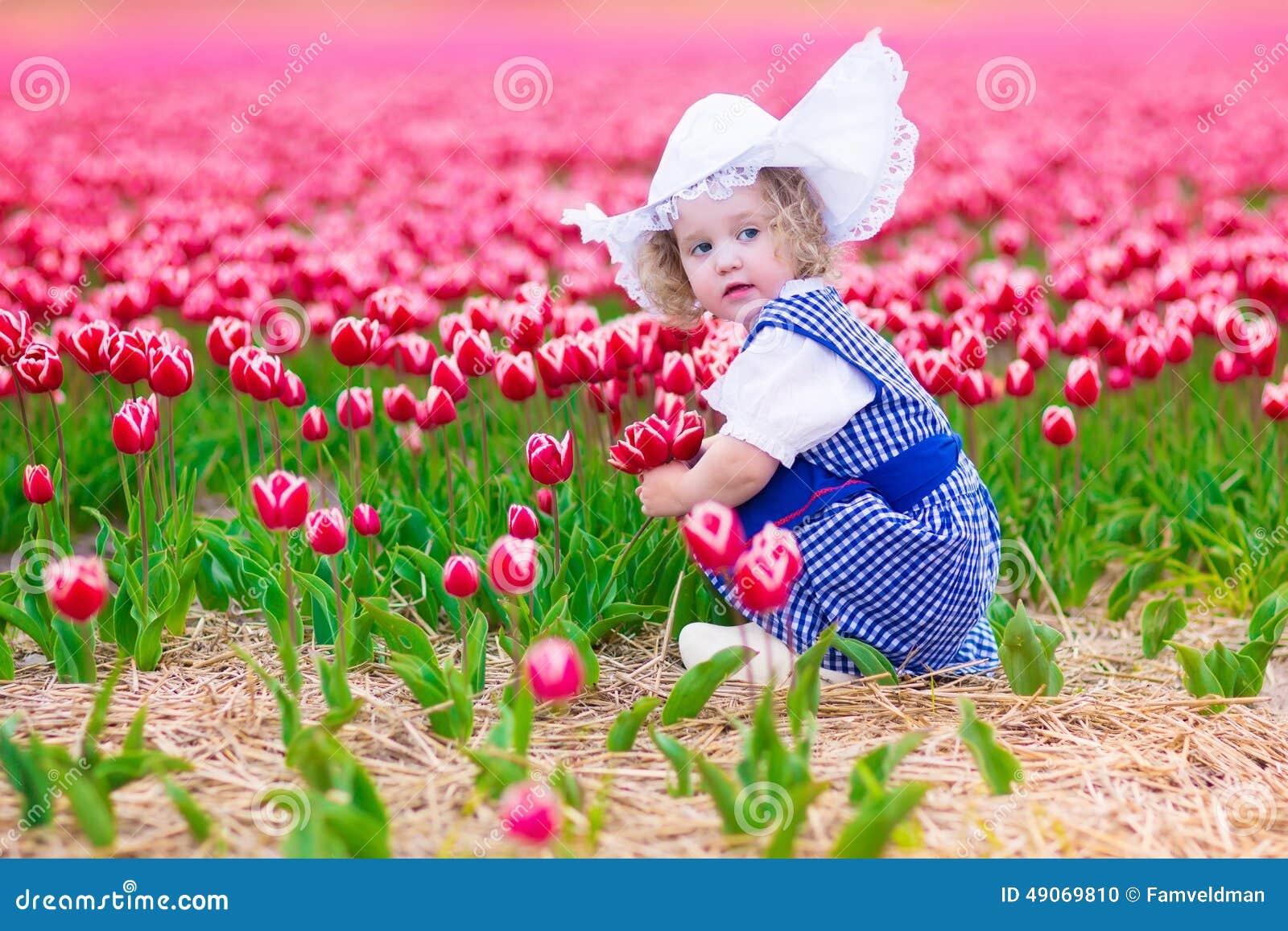 Dutch Girl In Tulip Field In Holland Stock Photo - Image ...