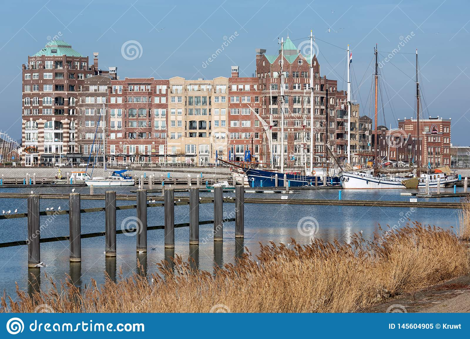 Dutch Harbor of Lelystad with sailing yachts and apartment building