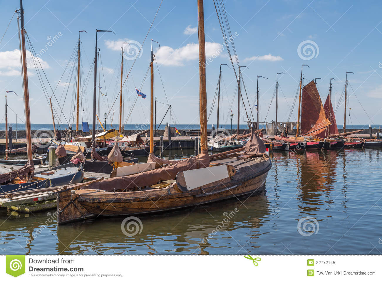 Dutch harbor of urk with traditional wooden fishing boats for Free fishing boats