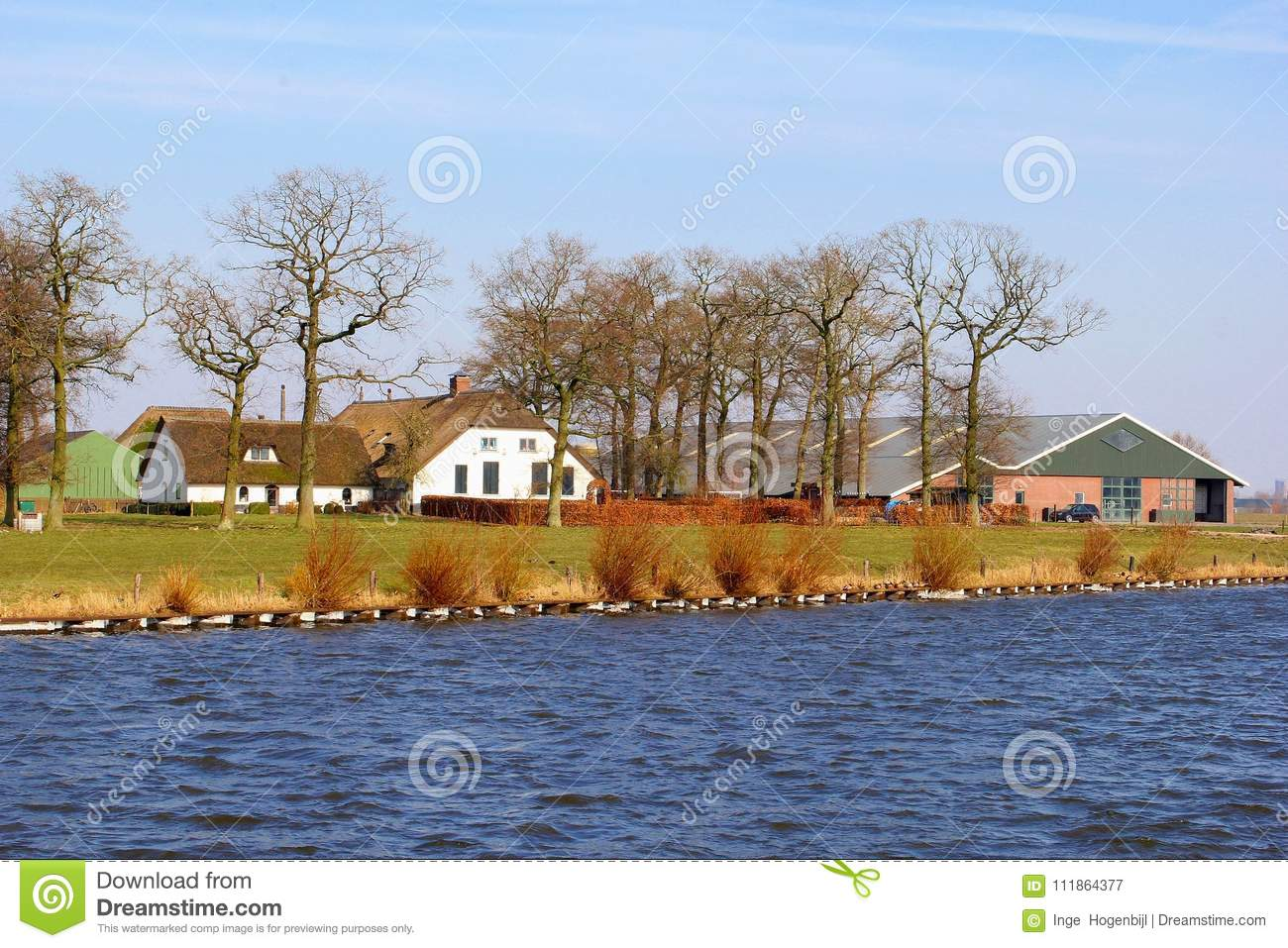 Dutch farm house buildings rural canal water, Netherlands