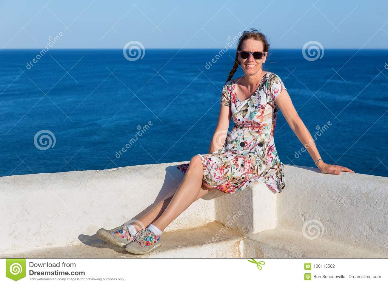 Dutch woman as tourist with blue sea