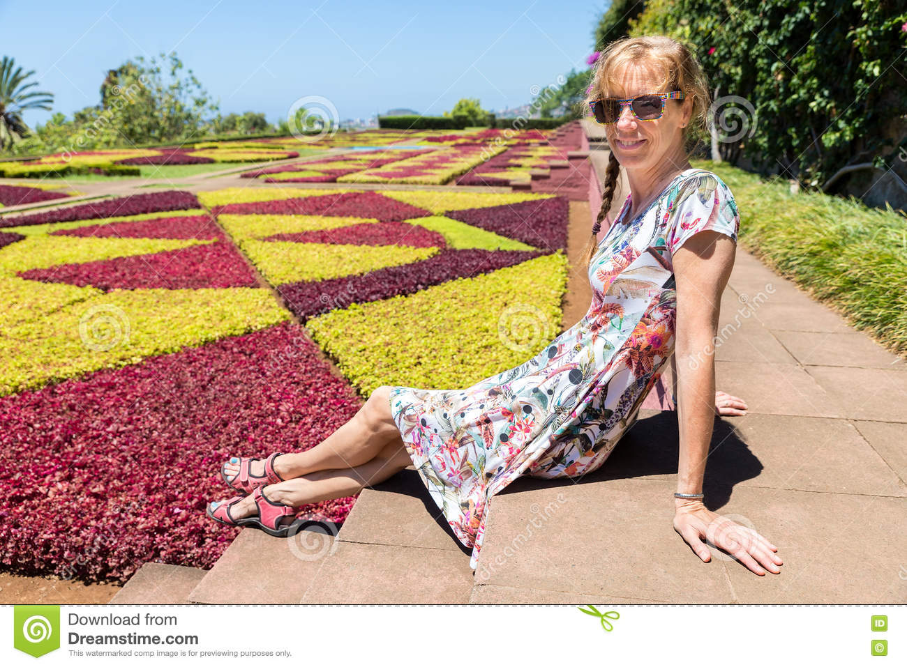 Dutch woman as tourist in botanical garden