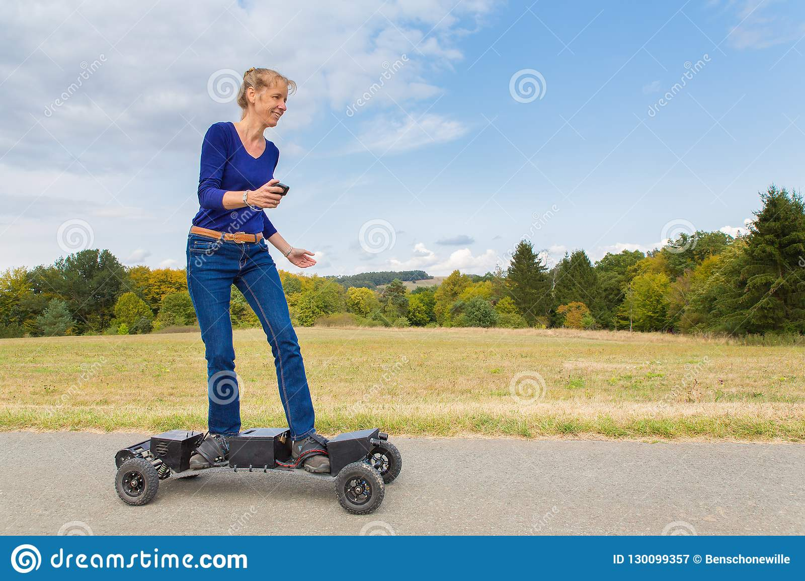 Dutch woman drives electric mountainboard in nature