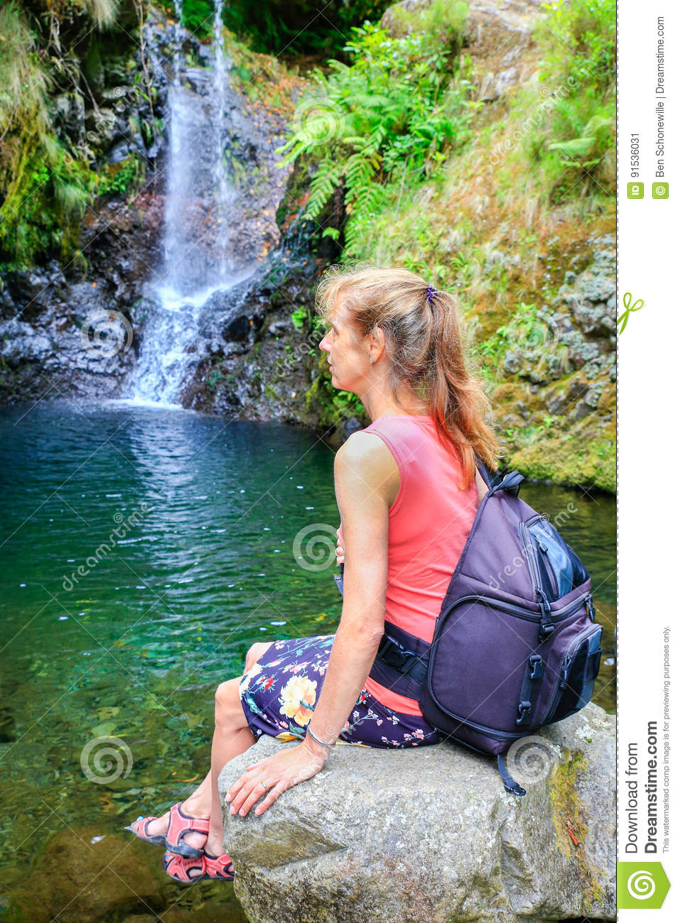 Happy Smiling Caucasian Woman Sitting On The Rock And